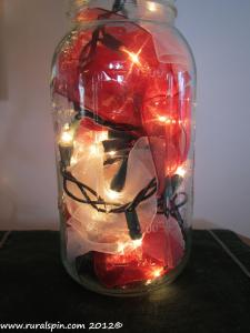 I literally jammed ribbon and Christmas lights into a jar. It looks lovely and was super cheap.
