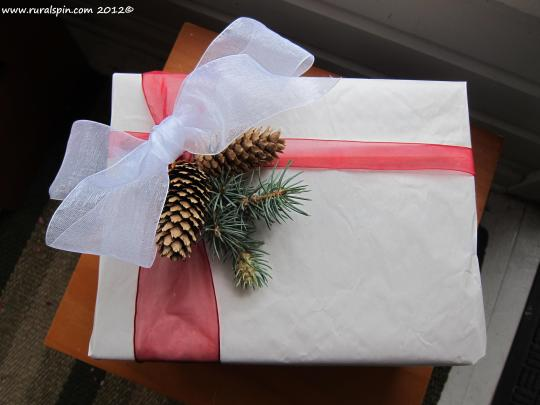 Used newsprint leftover from a move and the remains from the rest of my decoration frenzy made up my gift wrap.